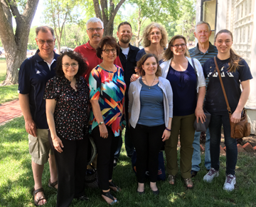 MB Historical Commission gathered in Hillsboro (June 8-9, 2018) for its annual general meeting. Pictured in the back row (l to r): Richard Thiessen, Jon Isaak (executive secretary), J Janzen (vice chair), Julia Reimer, Don Isaac (chair); (front row) Peggy Goertzen, Valerie Rempel (recording secretary), Hannah Keeney, Patricia Janzen Loewen, and Emma Sorensen (summer archival intern). Missing from the photo are Dora Dueck and Kevin Enns-Rempel.