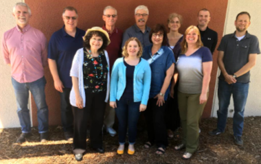 MB Historical Commission gathered in Fresno (June 7-8, 2019) for its annual general meeting. Pictured in the back row (l to r): Kevin Enns-Rempel, Richard Thiessen, Don Isaac (chair), Jon Isaak (executive secretary), Julia Reimer, Chris Koop, and J Janzen (vice chair); (front row) Peggy Goertzen, Hannah Keeney, Valerie Rempel (recording secretary), and Patricia Janzen Loewen.
