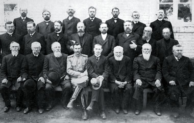 Delegates at the Conference of Mennonite Brethren Churches in May 1910. Russian government observer in front row.